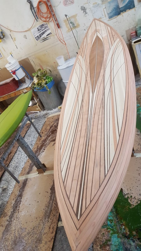 A beautiful wood inlay surfboard before it is stained