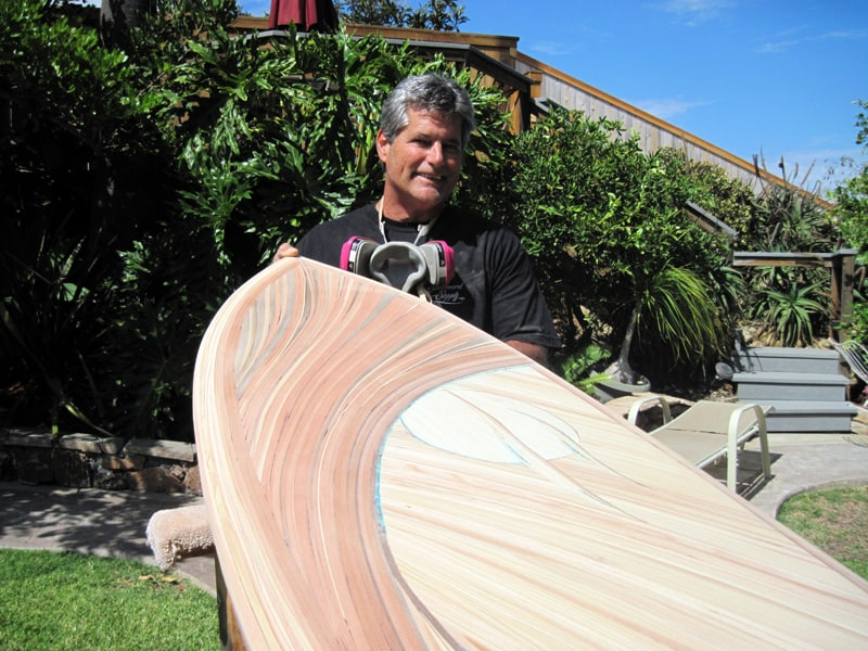Michael working on a surf board