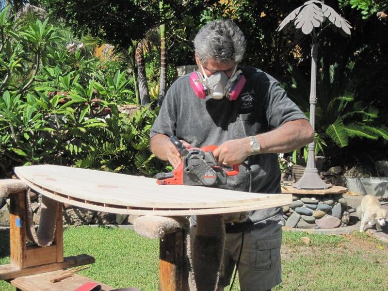 Michael working on sanding a board