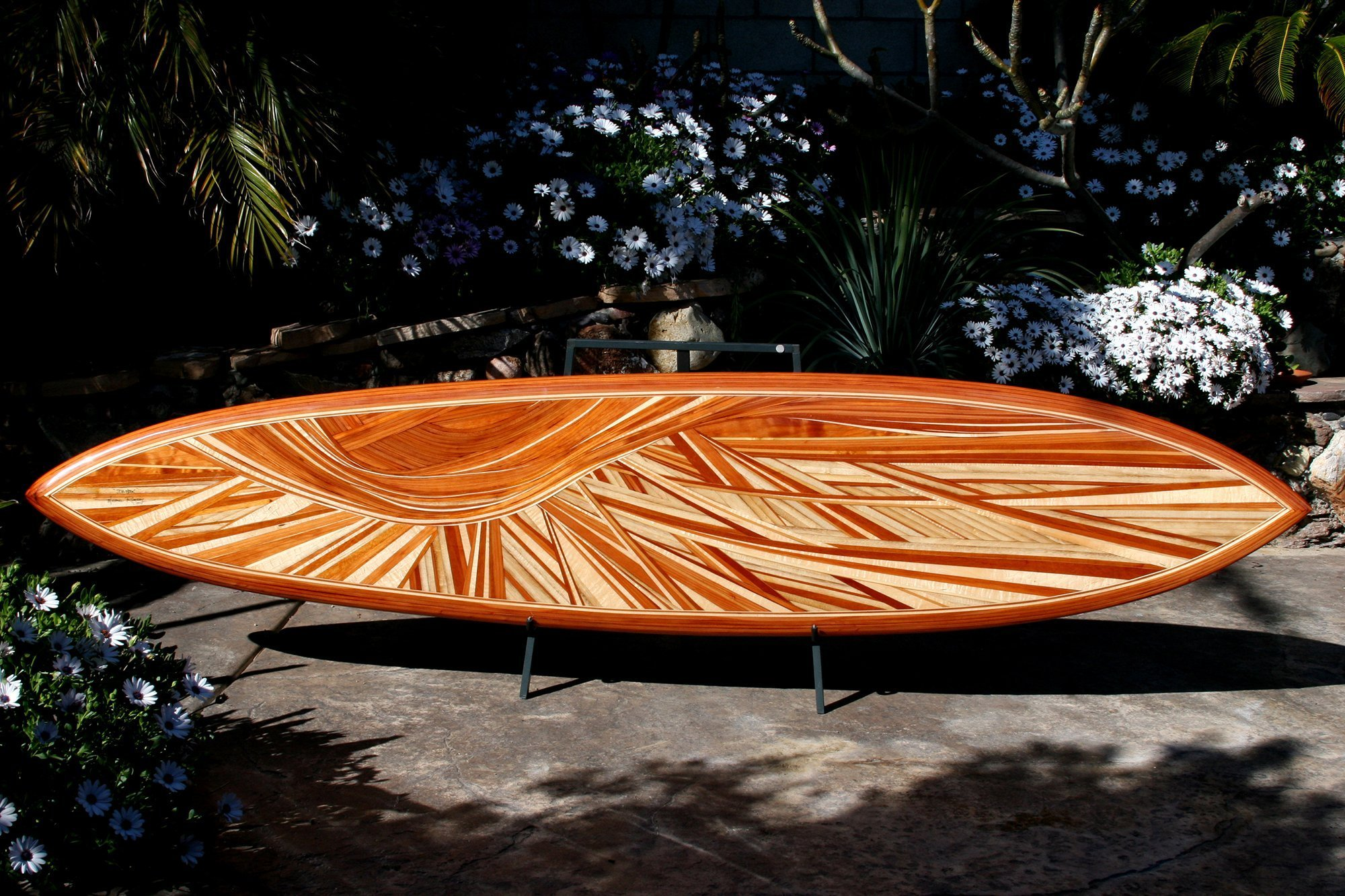decorative surfboard titled da hook built by mike rumsey who used a variety of lumber species void of paint or stain