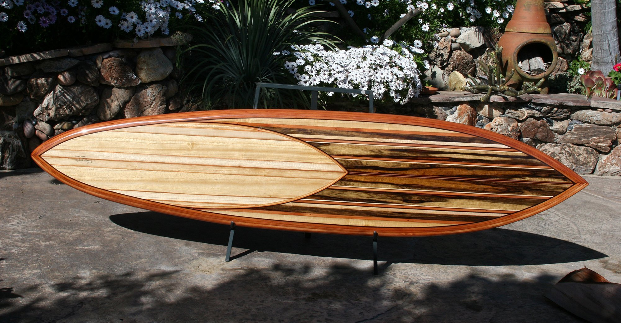 decorative wood surfboard titled lucky man built by mike rumsey using cocobolo and other exotic lumber void of paint or stain