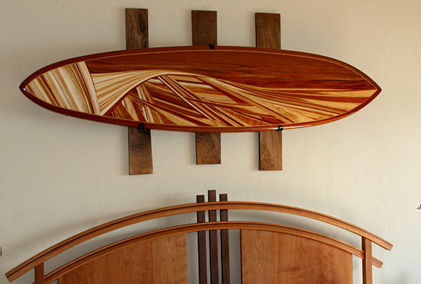 decorative surfboards are custom shaped by the artist and installed as high-end decor